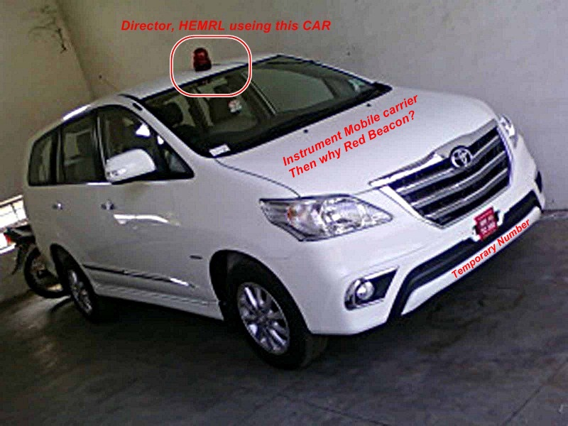 Sh Vikas Bhattacharya, Director, Using this Toyota Innova, The Red beacon is proof