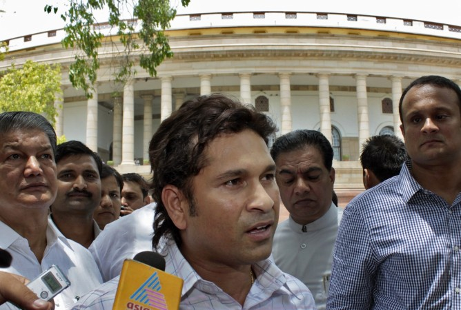 Sachin Tendulkar sought favours from defence minister Manohar Parrikar: Report Sachin Tendulkar, cricket player and Rajya Sabha member, reportedly sought favours from defence minister over a holiday retreat that was in a dispute with DRDO. In Picture: Tendulkar (C) speaks to the media after taking oath at the Indian parliament in New Delhi June 4, 2012 (Representational image).Reuters file